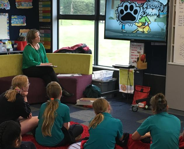 Waimakariri District Council community development facilitator Nicola Trolove shows Fernside School pupils a video to get them talking about being safe around dogs. Photo: David Hill