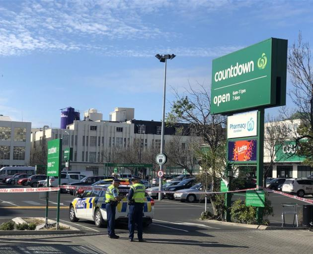 Police block one of the entrances to Countdown supermarket in central Dunedin. Photo: Craig Baxter