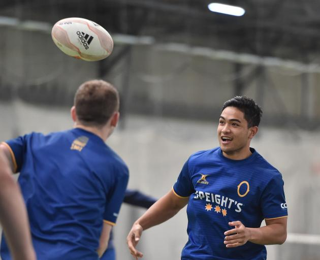 Otago and All Black first five-eighth Josh Ioane looks to get involved in a game at training at the Edgar Centre yesterday. Photo: Gregor Richardson