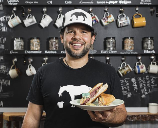 Joseph Walker with the Revell Street eatery's winning $10 'Detroit' toastie. Photo: Supplied