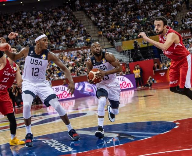 Kemba Walker takes the ball to the hoop for the United States as Turkey's Semih Erden is beaten....