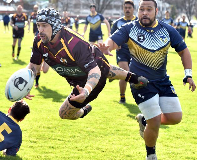 Southland Ram Korey Pennicott passes the ball under pressure from Otago Whaler Louis Till during...