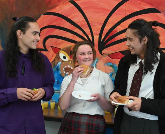 Sharing kai and conversing in te reo are (from left) Poutama Crossman-Nixon (21), and Logan Park High School pupils Bonnie Leishman (14) and younger brother Te Awa Crossman-Nixon (16), during an event to celebrate Maori Language Week at the school yesterd