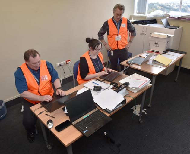 Monitoring developments at the Southern District Health Board's measles emergency operations centre at Wakari Hospital are (from left) centre manager Owen Black, administrator Toni Patterson and local controller Tom Scott. Photo: Gregor Richardson