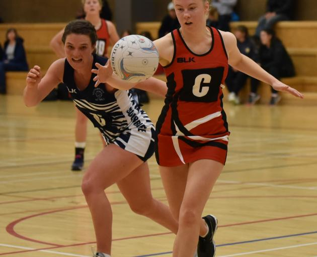 Lincoln A centre Madeleine Walker, right, beats her Southbridge oppositeBeth Williamson to the...