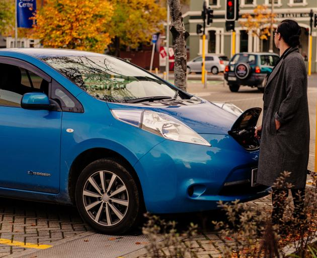 An EV owner charges up at the University of Otago charger. PHOTO: ALEX LOVELL-SMITH