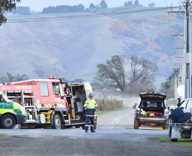 Emergency services attend a fatal crash near Outram yesterday. PHOTO: GREGOR RICHARDSON