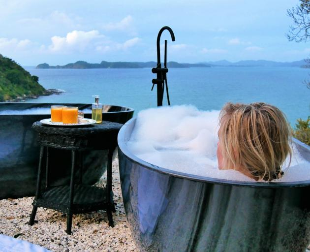 The divine decadence of twin outdoor tubs with an expansive view of sea, islands and sky. PHOTO:...