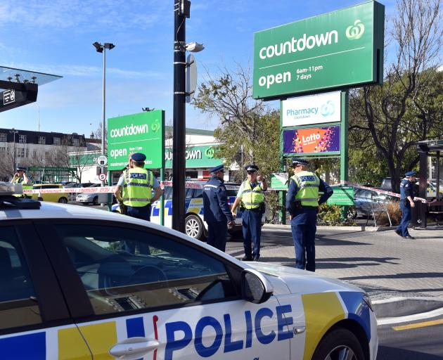 Some of the police who evacuated the Dunedin Central Countdown car park yesterday. PHOTOS: PETER...