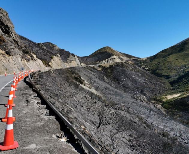 Heat from the fire left more than 200m of guardrails on Porters Pass buckled and lying on the road edge after the support posts were burned out in several sections. Photo: NZ Transport Agency