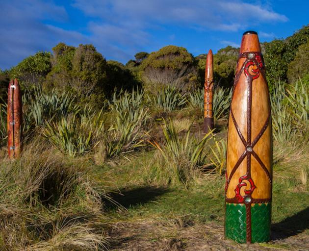 Three carved pou at Sealers Bay/Waikoropupu represent the enduring connection Ngai Tahu have with...