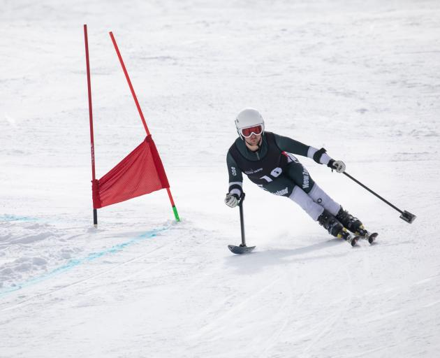 Wanaka's Adam Hall tears down the slope on his way to winning the giant slalom at the World Para Alpine Skiing Southern Hemisphere Cup at Cardrona yesterday. Photo: Neil Kerr
