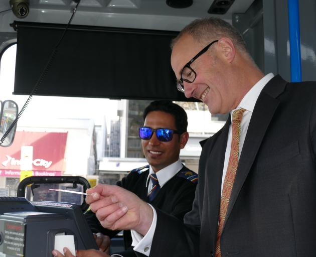 Minister Phil Twyford catches a Queenstown bus, driven by Mandeep Singh. PHOTO: DAISY HUDSON