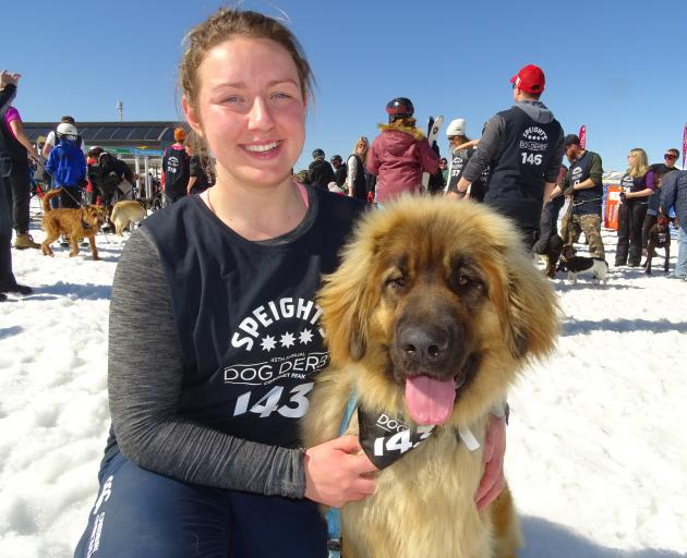 Molly Butt with her Leonberger dog Ellie, both of Tuatapere, before the whistle blew for the ``townie'' division. Photos: Miranda Cook.