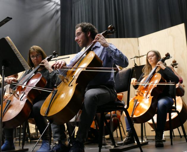 Joshua Ferrer, principal player in the Dunedin Symphony Orchestra's cello section, performs at...