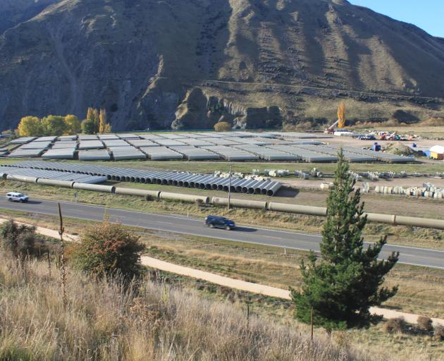 Thousands of pipes are stored near the base of the Waitaki dam, ready to be laid in the Kurow...