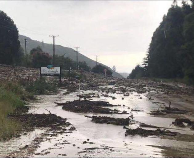 State  Highway 8  was blocked,  awash with debris yesterday. Photo: CODC