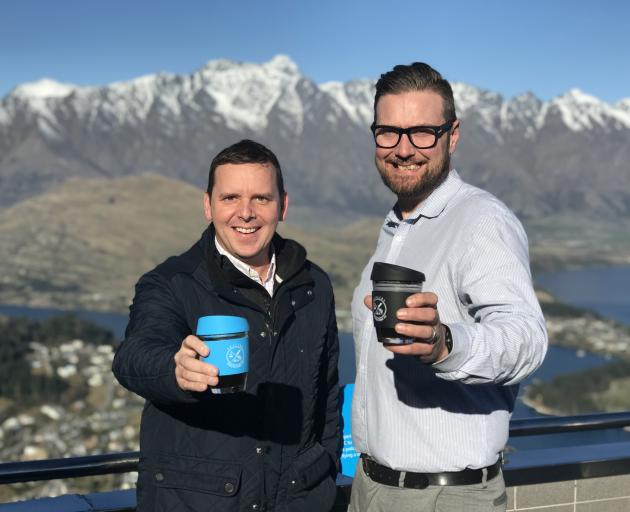 Skyline Queenstown's general manager Wayne Rose and operations manager Pierre Poyet with the tourism company's new cups. Photo: Supplied