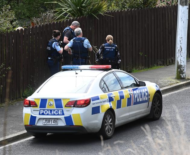 Armed police gather on Somerville St in response to an alleged assault on Saturday afternoon....