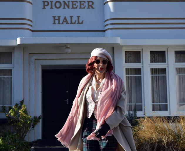 Artist Jenny Kendrick dances outside Pioneer Hall in Port Chalmers. Photo: Shawn McAvinue