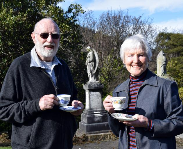 Heritage Roses Otago committee member Rex Thomson and Southern Heritage Trust trustee Ann Barsby enjoy a cuppa in Northern Cemetery in preparation for the Savoy afternoon tea next week to celebrate the replanting of heritage roses in the cemetery. Photo: