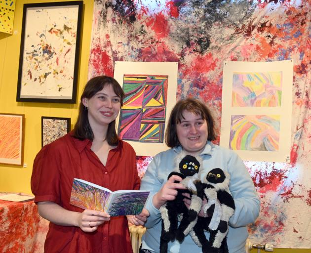 Surveying the ''Art for Our Sake'' exhibition are Studio 2 facilitator Megan Brady (left) and...