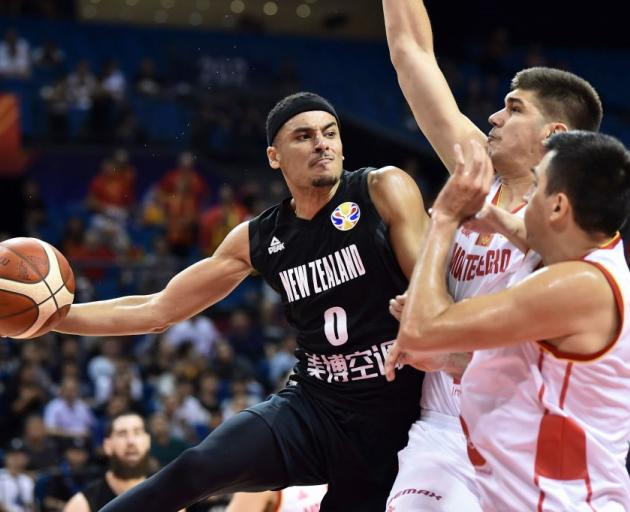 Tai Webster looks to pass out of a double team in the Tall Blacks win against Montenegro last...