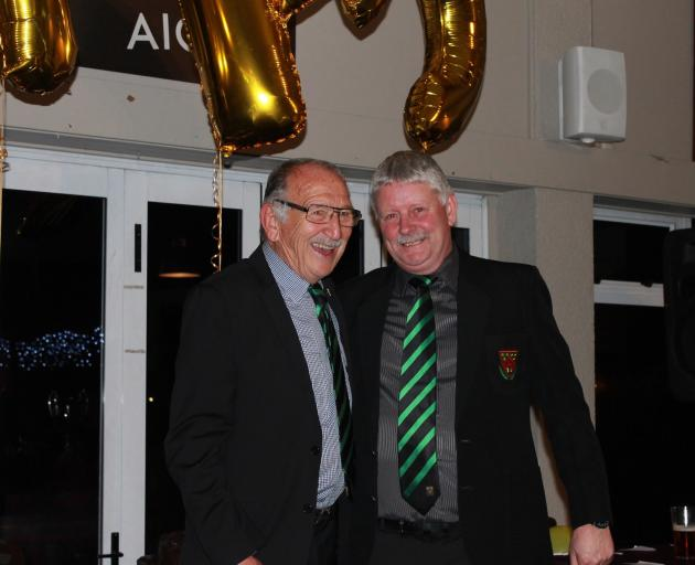 Tane Norton, left, presented Mike Webster with his Linwood Rugby Club life membership at the end...