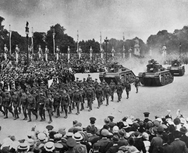 The Tank Corps march during the Victory celebrations on Peace Day in London. - Otago Witness, 30.9.1919.