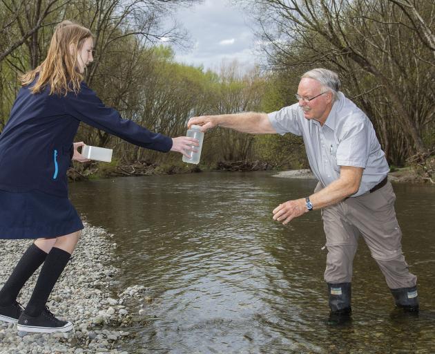 Kelvin Nicolle hands a water sample to Rolleston College student Brenda Pretorrus....