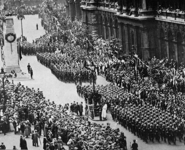 Looking down Whitehall, London, as American troops pass the memorial to the fallen during the great Victory March on Peace Day. - Otago Witness, 30.9.1919.