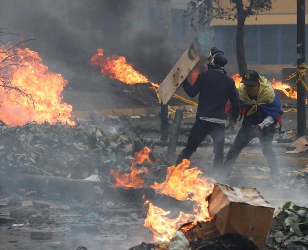 Demonstrators protest against Ecuador's President Lenin Moreno's austerity measures, in Quito,...