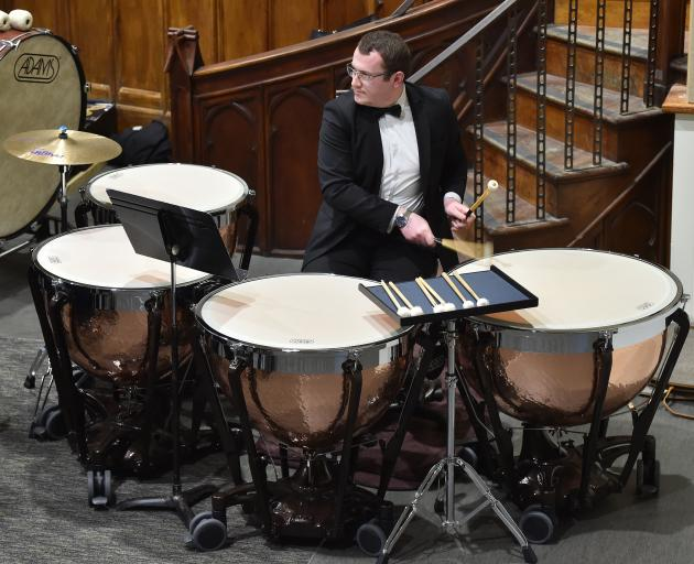Richard Gayfer plays St Kilda Brass' new timpani drums for the first time. The drums cost $30,000...