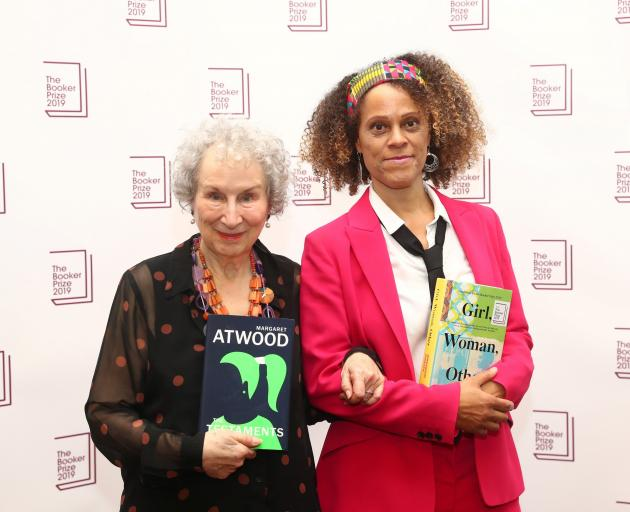 Margaret Atwood poses with Bernardine Evaristo after jointly winning the Booker Prize in London on Monday. Photo: Reuters