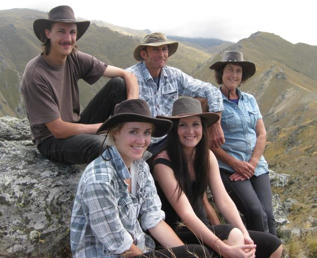 Parsons family members (clockwise, from back left) Andy, Richard, Jacqui, Jen and Anna gather during filming of their family for Country Calendar in 2012. PHOTO: JACQUI PARSONS