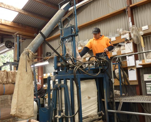 Hayden Hickey operates the core-testing machine. Photo: Adam Burns