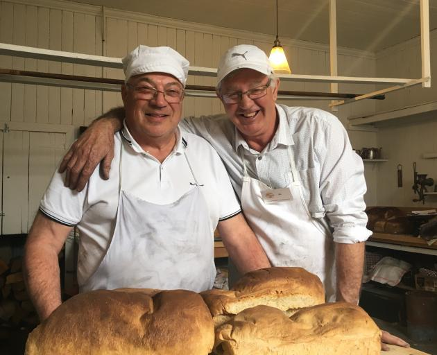 Dennis Kirkpatrick (left) and Ric Hunt had a busy day in the kitchen yesterday as hundreds...