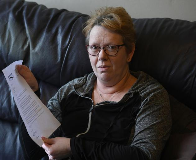 Dunedin bladder cancer patient Andrea Woodford holds a letter of apology sent to her by the Southern District Health Board. Photo: Linda Robertson
