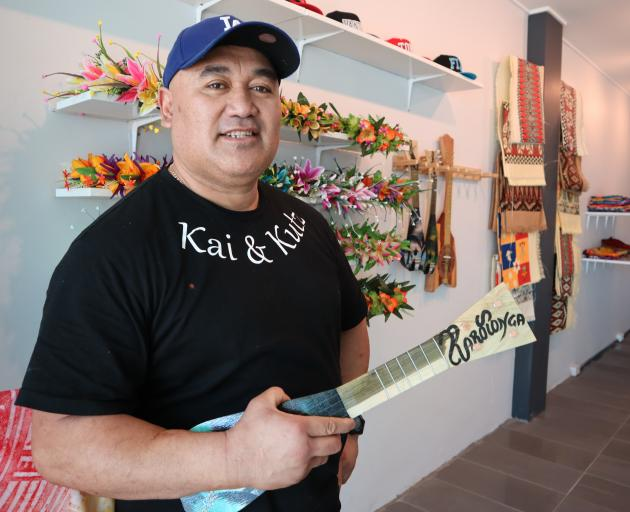 Mr Maireriki and some of the island merchandise on sale at Kai and Kutz.