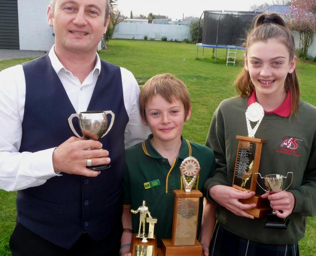 Winning speech makers: Phil, Leon and Taymah Wheeler with their haul of trophies. Photo: Mick Jensen