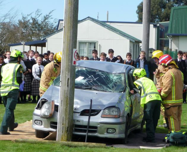 Seniors students at Mount Hutt College watch on as emergency services work at the scene of the...