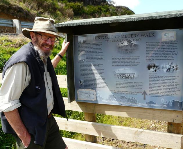 Project spokesman Fergus Sutherland inspects one of two new interpretation panels at the Chaslands Heathfield Cemetery, which will be reopened on Saturday. Photo: Richard Davison