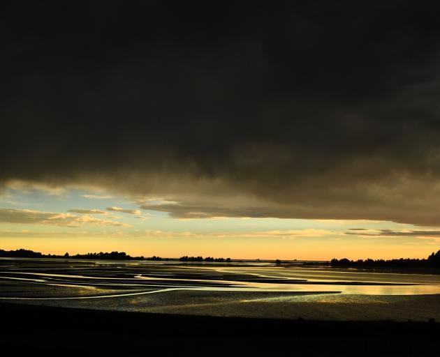 Rain clouds threaten above Blueskin Bay, north of Dunedin. PHOTO: STEPHEN JAQUIERY
