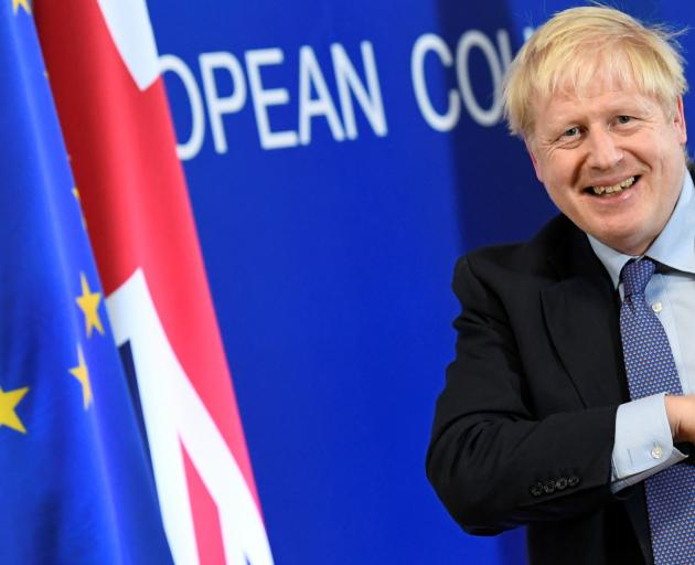 Britain's Prime Minister Boris Johnson leaves after a news conference at the European Union...