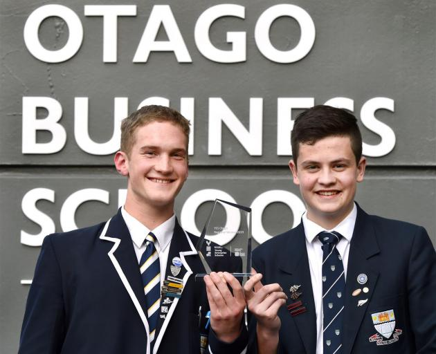 Oak Cologne's Ben Mason (18, left) and Thomas Geary (17) claimed the top spot at the Otago regional finals of the Young Enterprise Scheme last night. Photo: Peter McIntosh