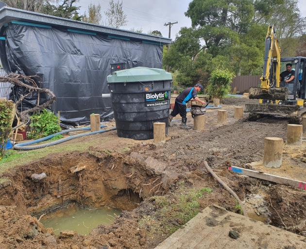 Foundations go in and a septic tank is installed in readiness for the climate safe house in...