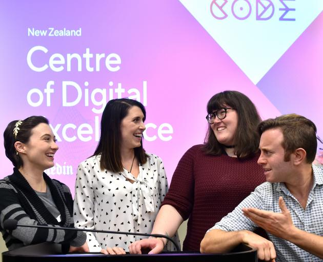 RocketWerkz concept artist Kiara du Toit (left), Runaway Play managing director Zoe Hobson, NZGDA chairwoman Cassandra Gray and RocketWerkz studio director Dave Oshry celebrate the launch of a digital hub in Dunedin. Photo: Peter McIntosh
