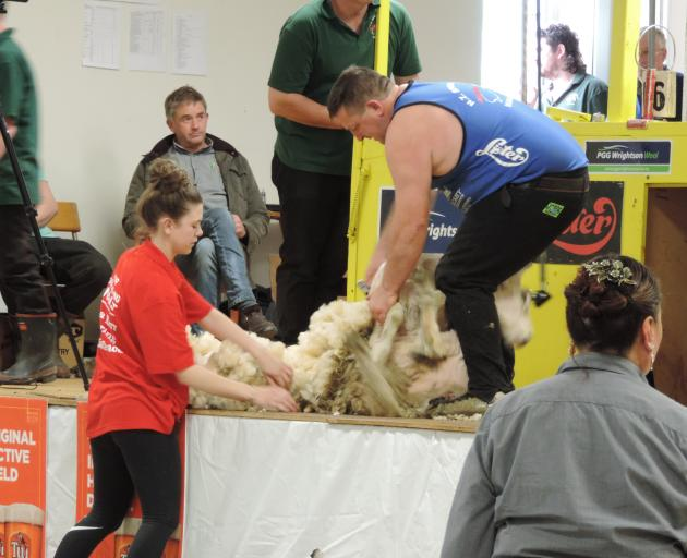 Lucy Avery, of Waimate, gathers the fleece shorn by Bill Melville, of Waimate, in the junior...