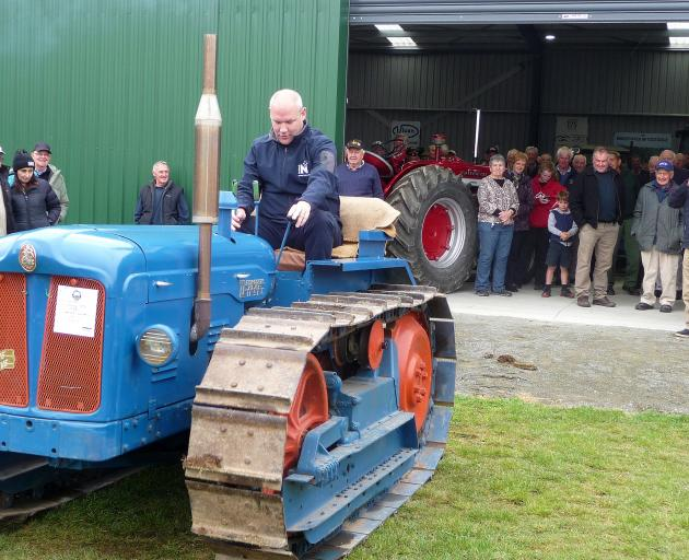 Rangitata MP Andrew Falloon tries out a Fordson Major tractor similar to one his grandfather used when he farmed at Waimate, during the official opening of the Mid Canterbury Vintage Machinery Club. Photos: Mick Jensen