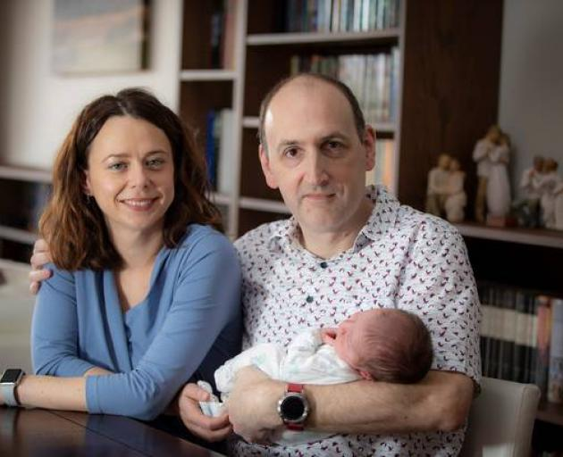 Irene Direnko-Smith discovered she had no immunity against measles late in her pregnancy, pictured with her husband Jolyon Direnko-Smith and their one-week-old son Lieve Direnko-Smith. Photo: NZ Herald